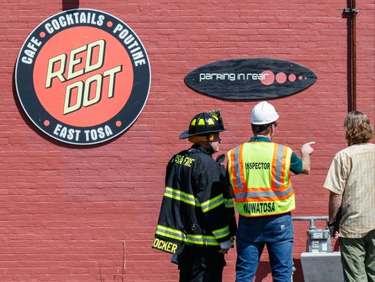 Emergency personnel inspect damage caused by a fire in the Red Dot bar/restaurant at 6715 W. North Ave. in Wauwatosa on Monday afternoon, May 7, 2018. Owners submitted plans for a mixed-use development where the music venue sits.