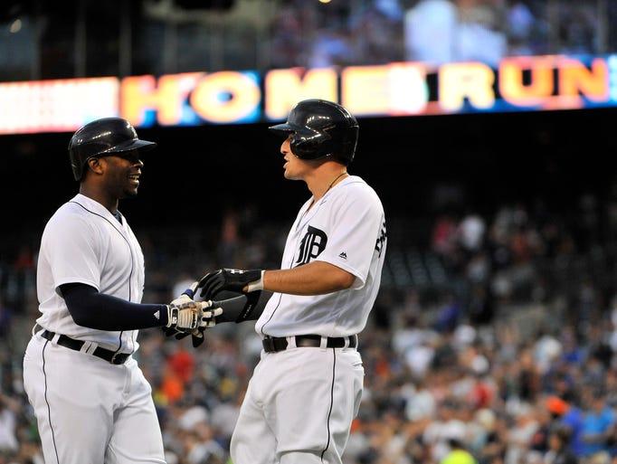 Detroit Tigers' Nick Castellanos, right, congratulates