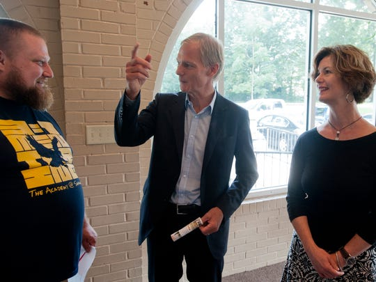Stephen Reily, center, and Caroline Heine, co-founders of Seed Capital Kentucky, talk with Chad Rehnberg, minister of Community Engagement, New Breed Church (which meets at the Academy @ Shawnee).