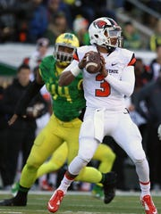 Oregon State's Marcus McMaryion looks to pass in the first half during Civil War Friday, Nov. 27, 2015, at Autzen Stadium in Eugene, Ore.