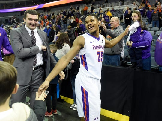 Duane Gibson of Evansville smiles while shaking hands with fans after defeating Missouri State 74-66 at the Ford Center in Evansville Saturday.