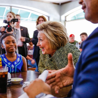 Democratic presidential candidate Hillary Clinton sits