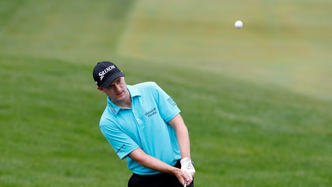 Russell Knox hits a chip shot on the 18th hole during the second round at Conway Farms Golf Club on Sept. 18, 2015.