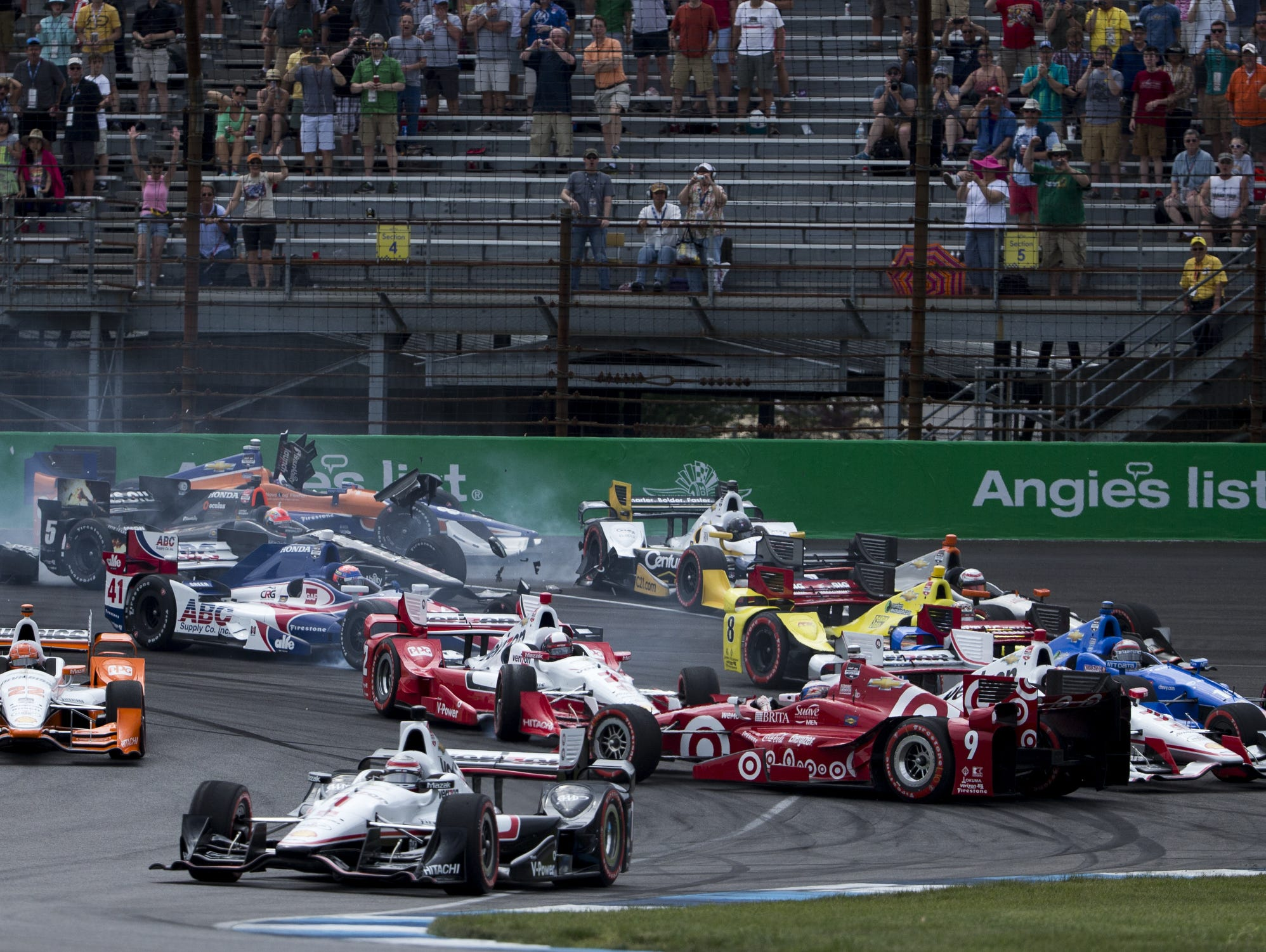 The first-lap contact between Helio Castroneves and Scott Dixon likely is being reviewed