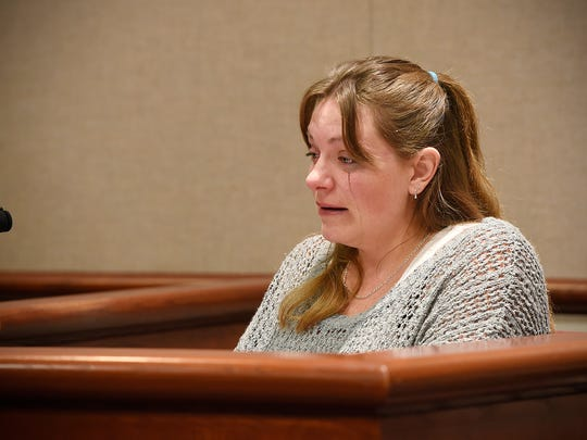 Dana Nistler reads a victim impact statement Wednesday during a sentencing hearing for Travis McKinney at the Benton County Courthouse in Foley. McKinney pled guilty to aiding an offender in the murder of Nistler's late husband, Jamie Wylie.
