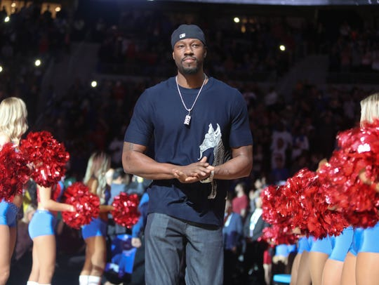 Former Pistons center Ben Wallace is introduced during