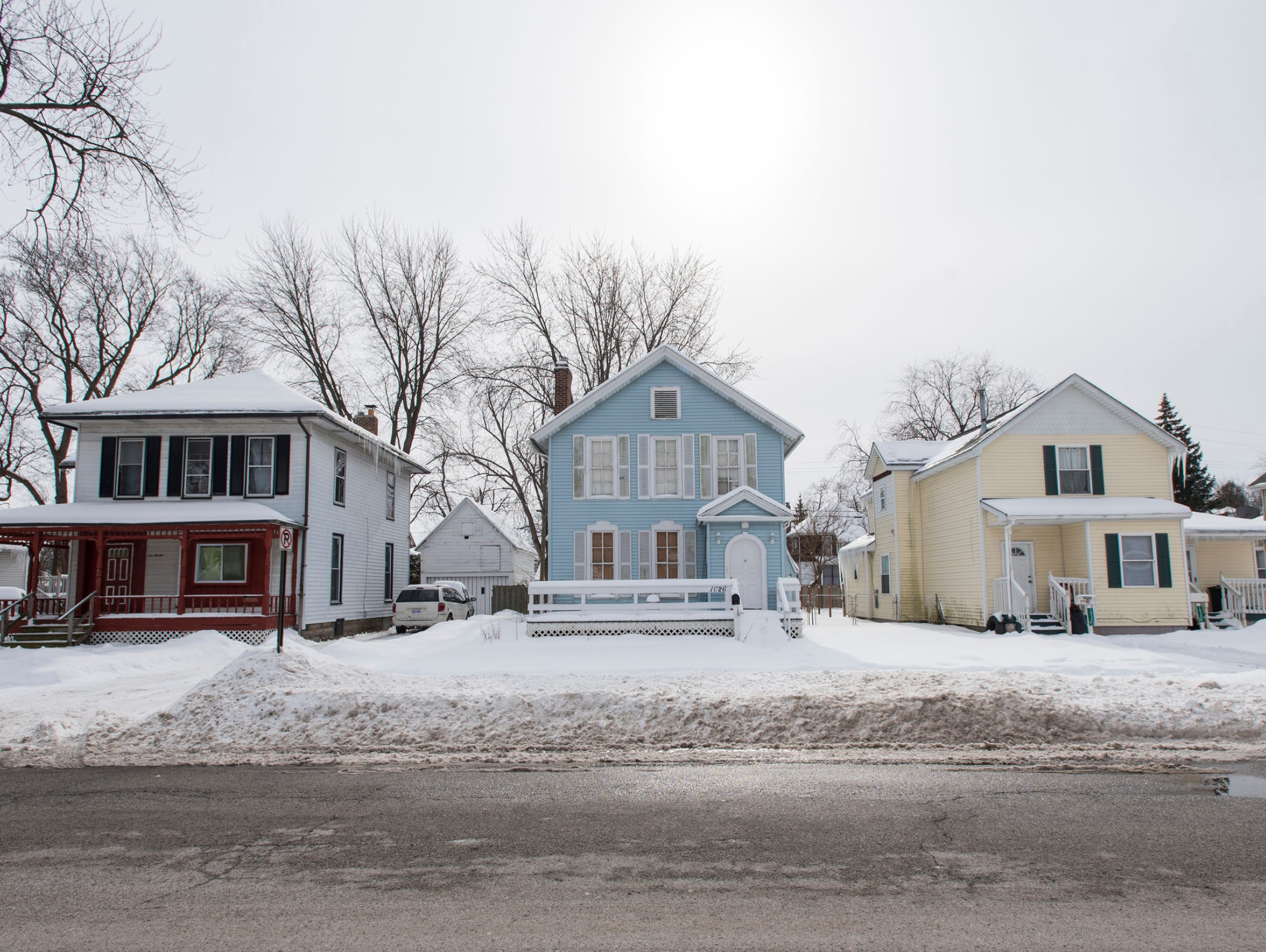 Two sober-living homes on Wall Street in Port Huron