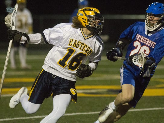 Eastern York's Cole Witman, left, is pursued by Spring