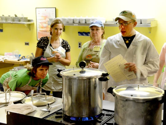 Christopher Sneed, right, during a canning class sponsored by UT Culinary Institute and UT Extension Service. (MICHAEL PATRICK/NEWS SENTINEL)