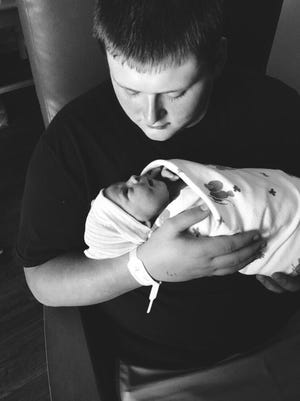 Gaiden Crelia with his daughter.