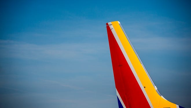 The first Southwest Airlines plane to depart from Cincinnati/Northern Kentucky International Airport pulls away from the gate Sunday, June 4, 2017.