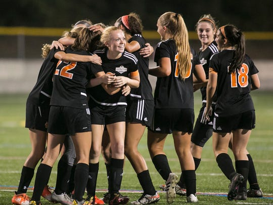 Central York players celebrate after Chloe Carns scored