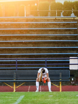 Bremerton senior Sophia Smith takes a moment to pray before a high school soccer match last fall. Smith's mother, Tracey, died last February and Smith paused before each match to pray.