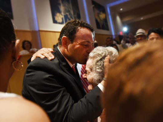 Paterson's new Mayor Andre Sayegh kisses his mother Raymonde Sayegh during the City of Paterson Inaugural Ceremony 2018 at the International High School in Paterson on 07/01/18.