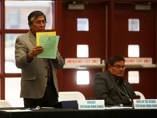 Navajo Nation Council Delegate Leonard Tsosie shows examples of the tribe's Certificate of Indian Blood and affidavit of birth during the town hall meeting about Real ID driver's licenses and identification cards on Friday at Navajo Technical University in Crownpoint.