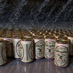 Water pours on cans of Yuengling Lager as they exit the pasteurizer at D.G.Yuengling & Son, Inc., America's oldest brewery. located in Pottsville, Penn., on Nov. 11, 2013.
