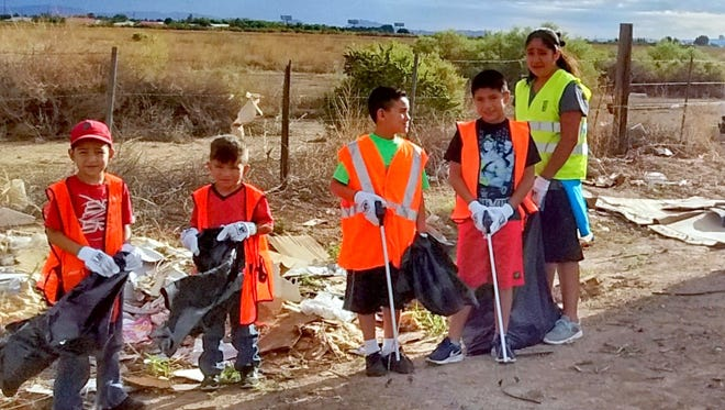Players from the Deming Youth Soccer League answered the advertisement from Keep Luna County Beautiful and were given a specific area in Luna County to pick up litter and haul away trash. Soccer players, from left, Jose Wilson, Dante Torres, Chuy Molina, Diego and Victoria Baca, were part of this particular clean-up crew that provided their services to the Keep Luna County Beautiful campaign. KLCB is looking for more youth groups to sign up and participate for funding provided by the county. KLCB will pay from $500 to $1,000 for organizations or youth groups to clean up Luna County. A baseball group also participated.