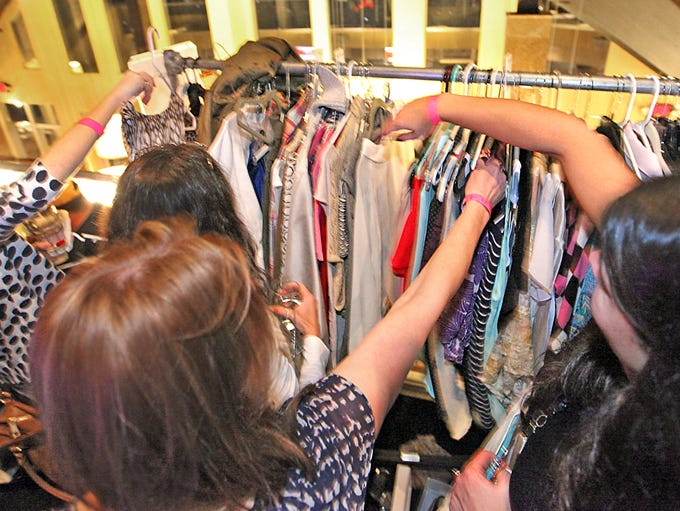 A detail of a portion of the clothes rack area during the Style Swap event at Bella Vita at Geist, Nov. 7, 2013.