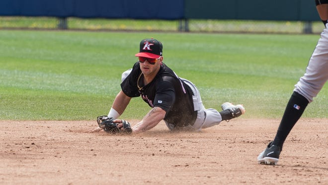 Kannapolis' Tate Blackman (20) makes a diving catch during a game against the Shorebirds on Thursday, April 26, 2018.