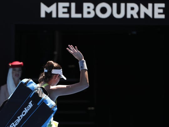 Spain's Garbine Muguruza waves as she leaves Rod Laver Arena following her second round loss to Taiwan's Hsieh Su-wei Thursday at the Australian Open tennis championships in Melbourne, Australia.