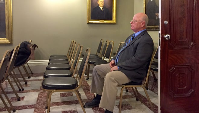 Sen. Norm McAllister, R-Franklin, listens as the Senate Rules Committee considers advancing a resolution on Wednesday that would suspend him from his Senate seat as he faces felony sexual assault charges. McAllister has said he will return to the Senate in January.