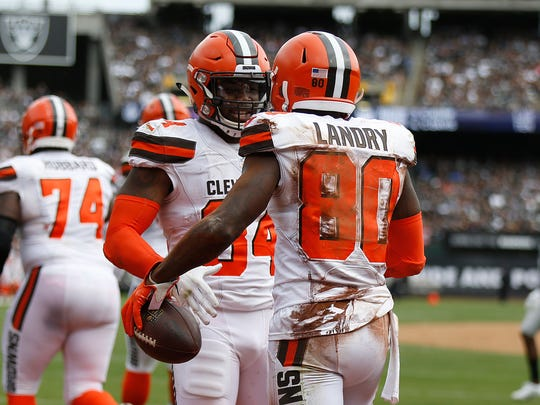 Cleveland Browns wide receiver Jarvis Landry (80) is congratulated by Carlos Hyde after scoring a touchdown against the Oakland Raiders during the second half of an NFL football game in Oakland, Calif., Sunday, Sept. 30, 2018. (AP Photo/D. Ross Cameron)