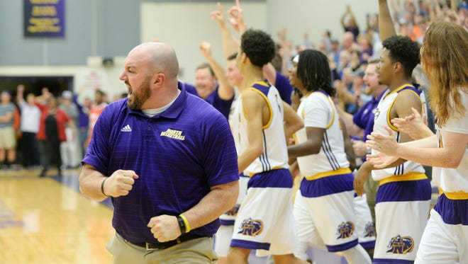 North Henderson coach Justin Parris reacts following Tuesday's second-round playoff win over visiting Erwin.