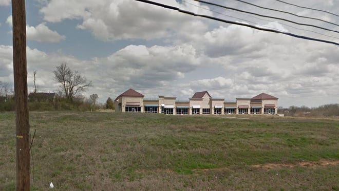 The abandoned mixed-used building sits next to O'Reilly's Auto Parts off Murfreesoboro Pike.