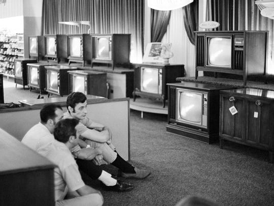 People watch the Apollo 11 Saturn V rocket launch on multiple TV's at a Sears department store in White Plains, N.Y. July 16, 1969.
