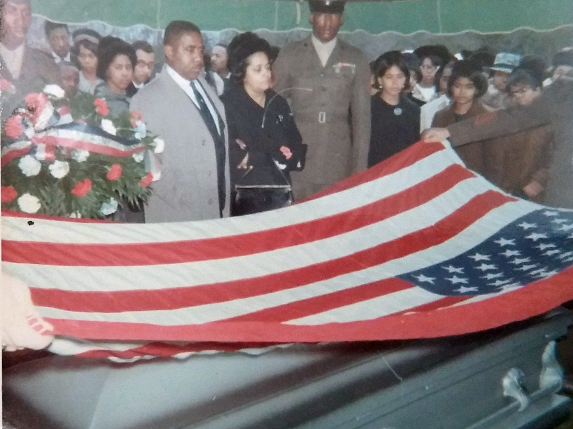 Folding the flag at Obie's funeral.