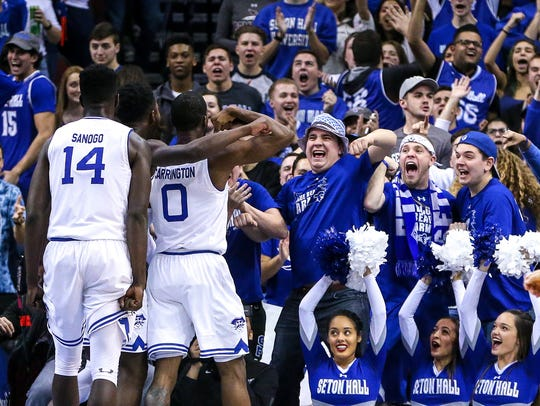 Seton Hall Pirates fans cheer in front of guard Khadeen