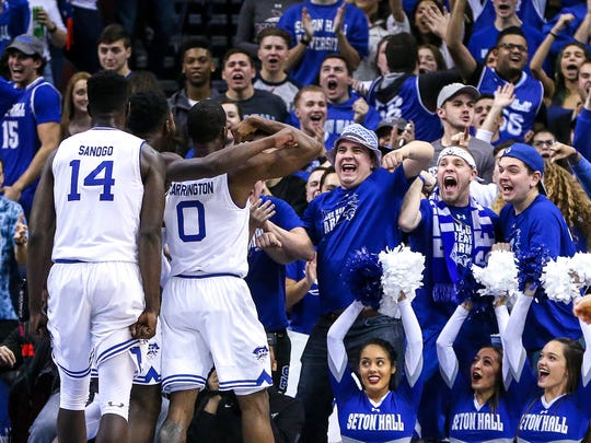 Seton Hall Pirates fans cheer in front of guard Khadeen Carrington (0) and forward Ismael Sanogo (14) during the first half against the Xavier Musketeers