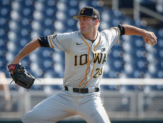 Iowa junior pitcher Nick Allgeyer fires a pitch against