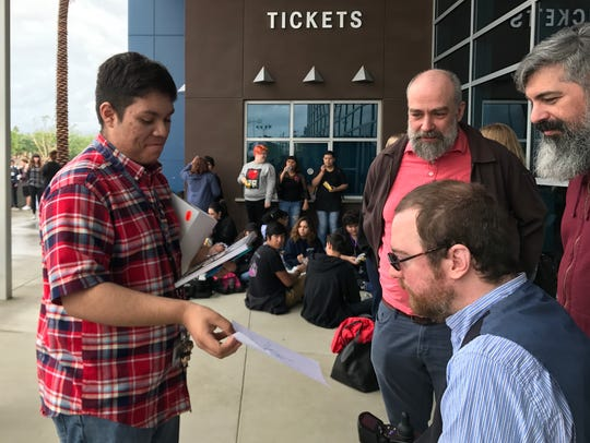 "Indio High School junior Steven Martinez meets Will Lautzenheiser following the screening of ""Stumped"" on Tuesday, Jan. 9, 2018, at Indio High School. Standing with Lautzenheiser are friend, Charles Delfino, and partner Angel Gonzalez."