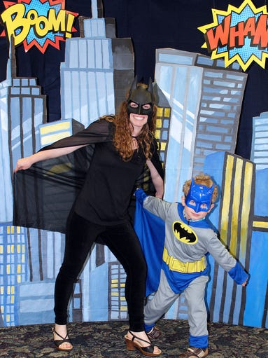 Marci and Blake Harman as Batman at the Anderson Township Park District's Mother-Son Superhero Dance May 9 at the Beech Acres Park RecPlex.