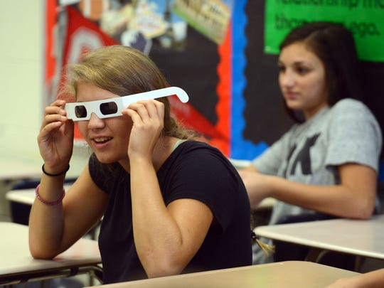 Lancaster High School freshman Kenzie Straits looks through a pair of glasses that simulates damaged corneas Tuesday, Sept. 19, 2017, during a health class at Lancaster High School in Lancaster. Straits and her classmates were receiving organ donation education which is now a mandated part of all high school health classes in the state.