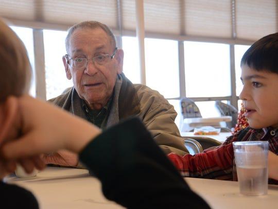Bob Dillard, center, chats with Dylan Kuntz and a friend