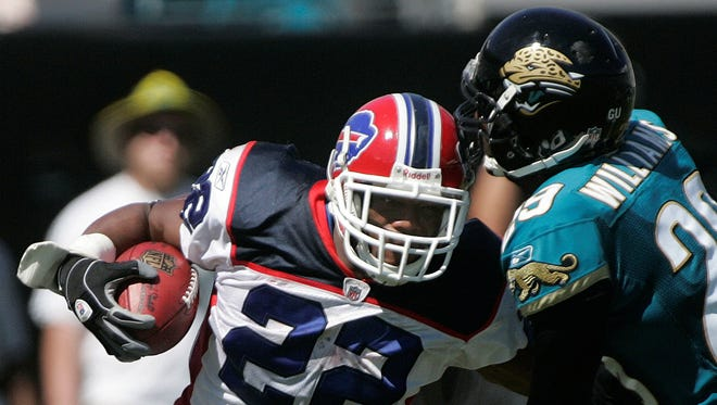 Buffalo Bills running back Fred Jackson, left, runs after the catch as Jacksonville Jaguars cornerback Rashean Mathis attempts to make the tackle during the third quarter.