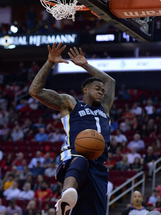 Memphis Grizzlies forward Jarell Martin (1) finishes off a dunk against the Houston Rockets in the first half of an NBA basketball game, Monday, Oct. 23, 2017, in Houston. (AP Photo/George Bridges)