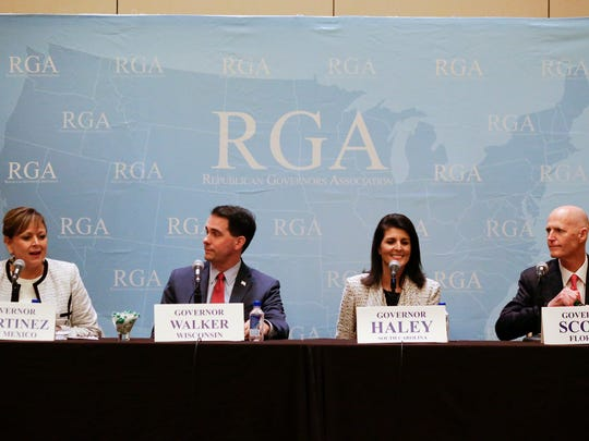 New Mexico Gov. Susana Martinez, left, speaks during a news conference with Wisconsin Gov. Scott Walker, South Carolina Gov. Nikki Haley and Florida Gov. Rick Scott at the Republican Governors Association annual conference, Tuesday, Nov. 15, 2016, in Orlando, Fla.