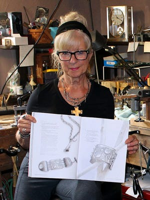 Joanne McNamara displays the article in Bella Amoire Jewelry, coming out in September and featuring her jewelry.
