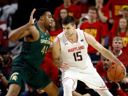 Maryland center Michal Cekovsky drives against Michigan