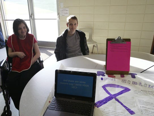 Jessica and Tyler Schmidt show off Tyler's project