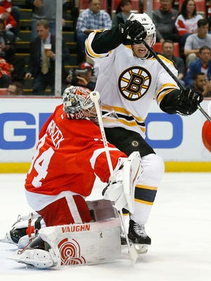 Detroit Red Wings goalie Petr Mrazek (34) blocks a shot as Boston Bruins right wing Reilly Smith tries to redirect it April 2, 2015.