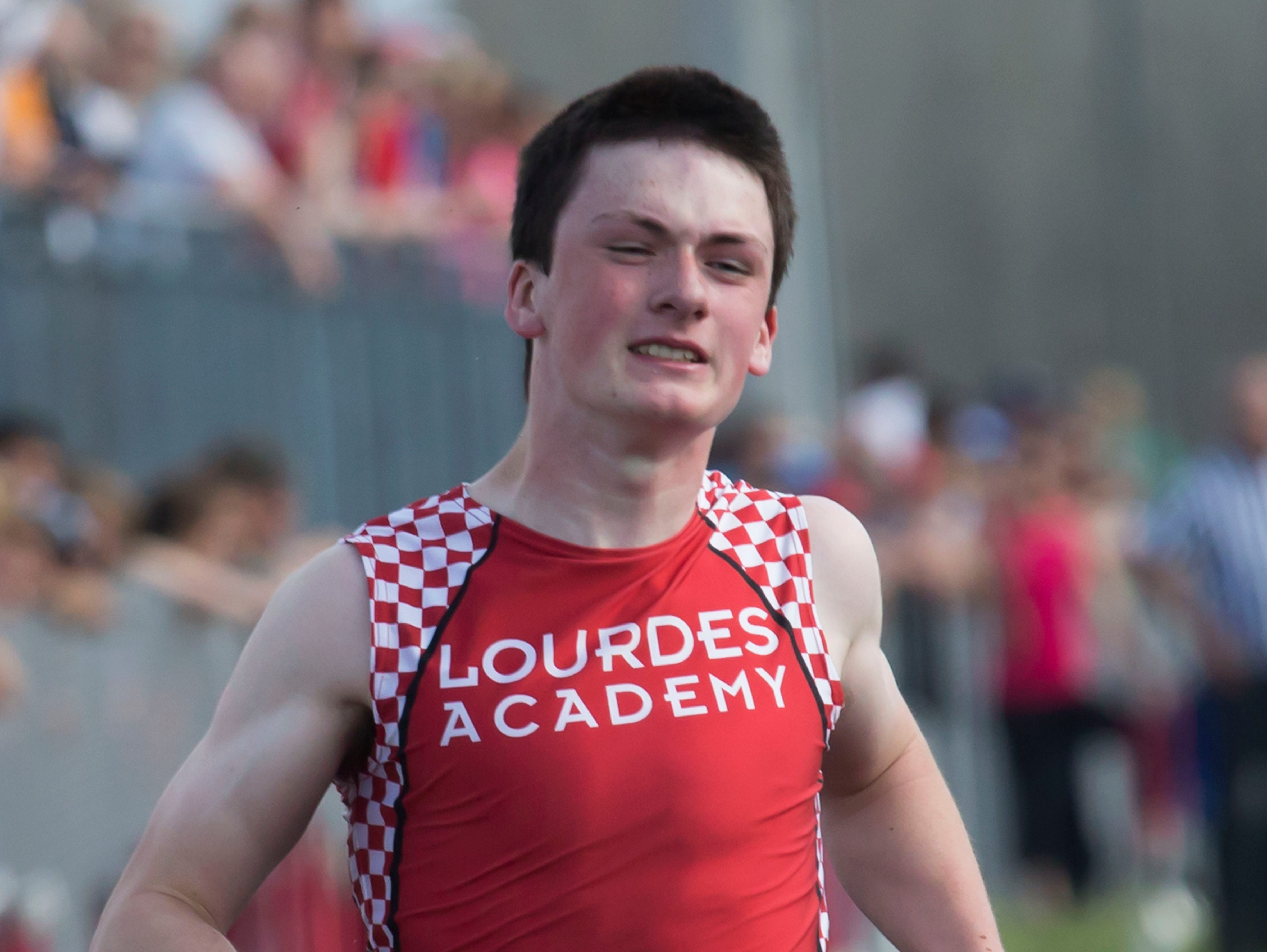 Lourdes Academy's Christian Pecore run the 100 meter dash in a Division 3 track meet at Princeton High School May 29, 2015.