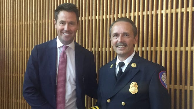 Newly confirmed chief of teh Pensacola Fire Department, David Allen (right), stands with Pensacola Mayor Ashton Hayward.