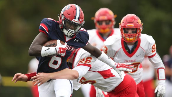 Stepinac's Trill Williams (6) breaks a tackle for a