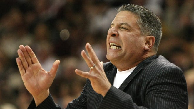 FILE - In this March 6, 2010 file photo, Tennessee head coach Bruce Pearl reacts during the second half of an NCAA college basketball game in Starkville, Miss. Auburn has hired former Tennessee coach Pearl to lead a struggling basketball program. The school announced the hiring on Tuesday, March 18, 2014, of the charismatic coach, who remains under a show-cause penalty from the NCAA.