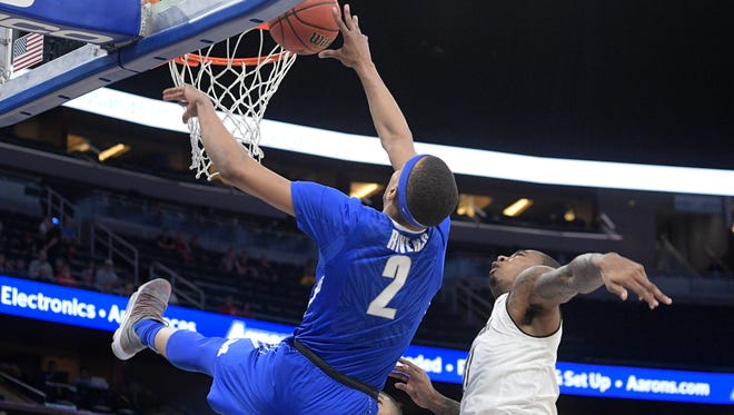 Memphis forward Jimario Rivers (2) falls backwards while going up for a shot in front of Cincinnati forward Gary Clark (11) during the first half of an NCAA college basketball game in the semifinals at the American Athletic Conference tournament Saturday, March 10, 2018, in Orlando, Fla. Rivers left the game after hitting his head on the floor on the play.
