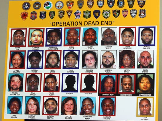 A posted shows 31 people arrested in February under Operation Dead End, a sweep of people accused of drug selling and gun violence in Asbury Park.